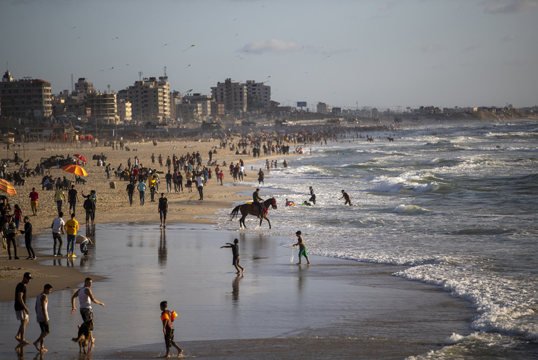 Palestinians enjoy a sunny day on the beach of Gaza City, Friday, May 29, 2020. (AP Photo/Khalil Hamra)