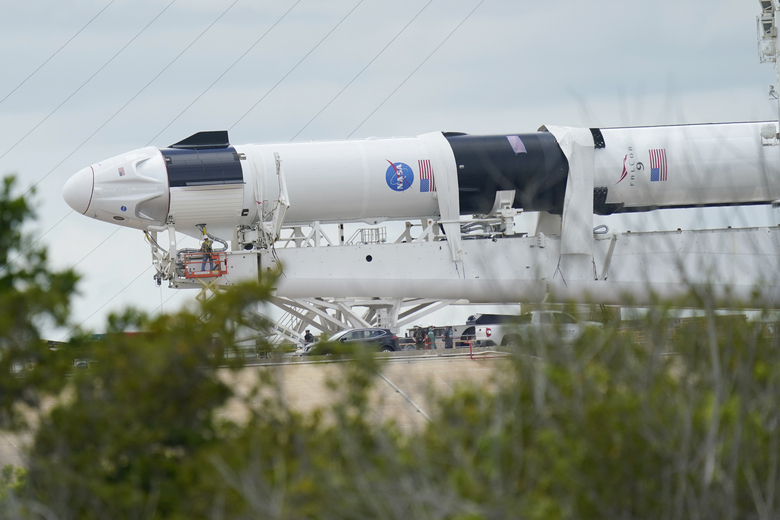 The SpaceX Falcon 9, with Dragon crew capsule is serviced on Launch Pad 39-A, Tuesday, May 26, 2020, at the Kennedy Space Center in Cape Canaveral, Fla. Two astronauts will fly on the SpaceX Demo-2 mission to the International Space Station scheduled for launch on May 27. For the first time in nearly a decade, astronauts will blast into orbit aboard an American rocket from American soil, a first for a private company. (AP Photo/David J. Phillip)