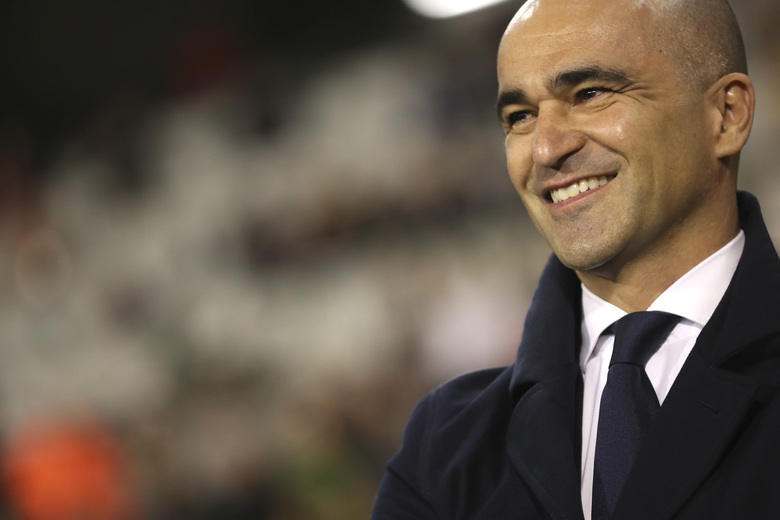 FILE – In this photo taken on Thursday, Oct. 10, 2019, Belgium's coach Roberto Martinez smiles prior to the Euro 2020 group I qualifying soccer match between Belgium and San Marino at the King Baudouin Stadium in Brussels. Martinez has signed a new contract to lead the Red Devils through the 2022 World Cup in Qatar. (AP Photo/Francisco Seco)