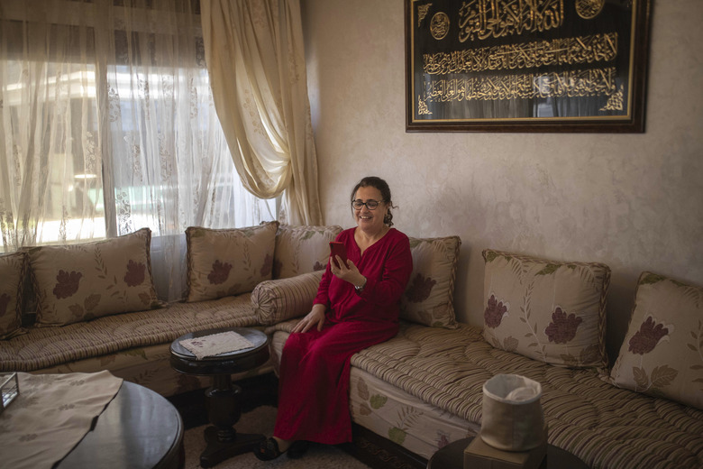 Afifa, 61, video calls with their grandson on the first day of Eid in lockdown due to the Coronavirus pandemic, in Casablanca, Morocco, Sunday, May 24, 2020. Instead of mass prayers and large family gatherings filled with colorful clothes, gifts, and traditional foods, millions of Moroccan Muslims celebrated Eid Al-Fitr at home, subdued and isolated amid their country's newly extended coronavirus lockdown. (AP Photo/Mosa'ab Elshamy)
