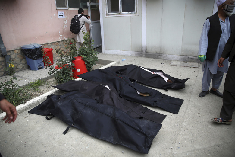 Bodies of people killed during an attack lie on the ground at a maternity hospital in Kabul, Afghanistan, Tuesday, May 12, 2020. Militants stormed a maternity hospital in the western part of Kabul on Tuesday, setting off an hours-long shootout with the police and killing over a dozen people, including two newborn babies, their mothers and an unspecified number of nurses (AP Photo/Rahmat Gul)