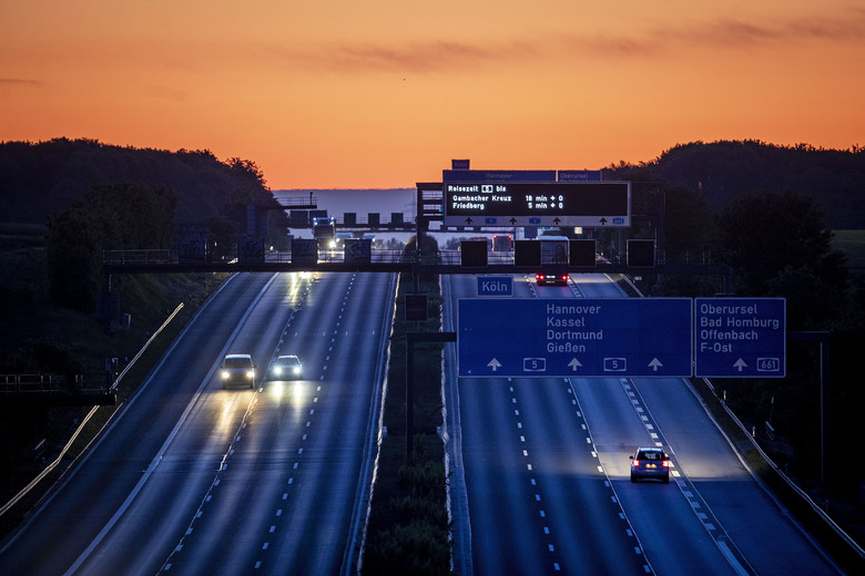 Cars and trucks are driven on a relatively empty highway in Frankfurt, Germany, Wednesday, May 6, 2020. Due to the coronavirus a lot less traffic is seen during the day. (AP Photo/Michael Probst)