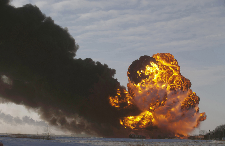 FILE – In this Dec. 30, 2013 file photo, a fireball goes up at the site of an oil train derailment near Casselton, N.D. The Trump administration on Monday, May 11, 2020, moved to block a Washington state law that imposed safety restrictions on oil shipments by rail in response to numerous explosive accidents. The Department of Transportation determined federal law preempts the state's mandate that crude from the oil fields of the Northern Plains have more of its volatile gases removed prior to being loaded onto rail cars. (AP Photo/Bruce Crummy, File)