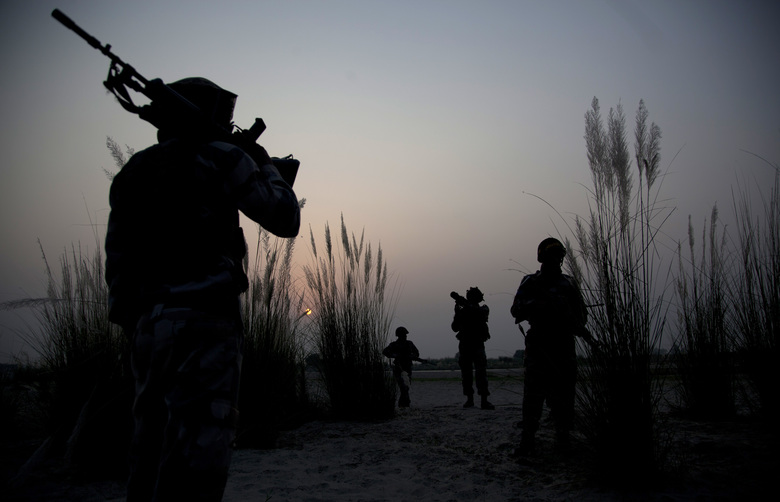 FILE- In this Oct. 4, 2016 file photo, Indian army soldiers patrol near the highly militarized Line of Control dividing Kashmir between India and Pakistan, in Pallanwal sector, India. The Indian army says five security personnel and two militants have been killed in a major spike in fighting in disputed Kashmir when the army and police stormed a house where rebels were holding hostages. (AP Photo/Channi Anand, File)