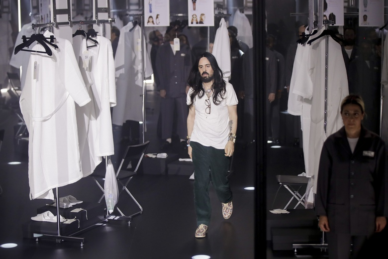 FILE – In this Wednesday, Feb. 19, 2020 file photo, Designer Alessandro Michele walks out at the end of Gucci's Fall/Winter 2020/2021 collection, presented in Milan, Italy. Gucci and St. Laurent are two of the highest profile luxury fashion houses to announce they will leave the fashion calendar behind, with its relentless four-times-a-year rhythm, shuttling cadres of fashionistas between global capitals where they squeeze shoulder-to-shoulder around runways for 15 breathless minutes. (AP Photo/Luca Bruno, File)