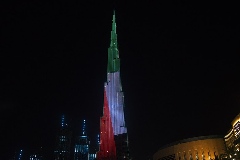 """The Burj Khalifa, the world's tallest building, displays the Emirati flag as part of the """"World's Tallest Donation Box"""" campaign in Dubai, United Arab Emirates, Monday, May 11, 2020. The campaign raised money for meals to the hungry amid the coronavirus pandemic. (AP Photo/Jon Gambrell)"""