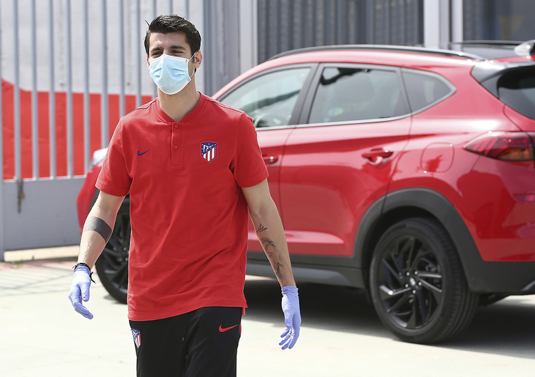 In this photo provided by Atletico Madrid, Alvaro Morata wearing a face mask and gloves attends the club's training ground in Madrid, Spain, on Wednesday May 6, 2020. Soccer players in Spain returned to their team's training camps Wednesday for the first time since the country entered a lockdown nearly two months ago because of the coronavirus pandemic. (Atletico Madrid via AP)
