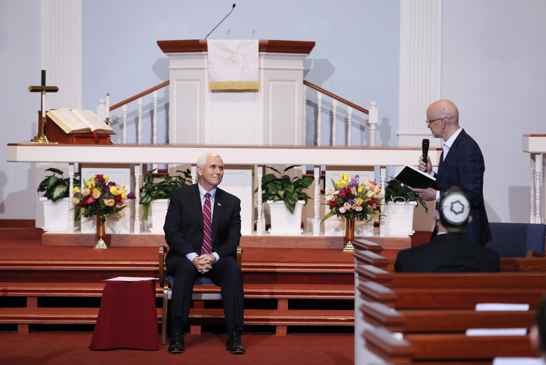 Vice President Mike Pence listens to Westkirk Church Senior Pastor Michael Mudlaff, right, during a discussion with local faith leaders to encourage them to resume in-person church services in a responsible fashion in response to the coronavirus pandemic, Friday, May 8, 2020, in Urbandale, Iowa. (AP Photo/Charlie Neibergall)