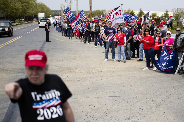 Supporters line the side of the road waiting for President Donald Trump's motorcade to drive past on Thursday, May 14, 2020, in Allentown, Pa. (AP Photo/Matt Rourke)