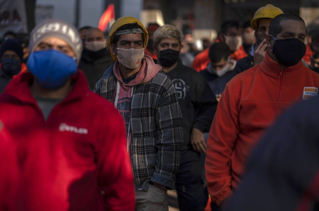 In Montevideo, Uruguay, protesters – wearing face masks and social distancing – listen to a speaker during a  half-day strike near the Legislative Palace on Thursday, June 4, 2020. They were protesting government-proposed reforms which they say  would restrict workers' rights, including the right to strike and protest. (Matilde Campodonico / The Associated Press)
