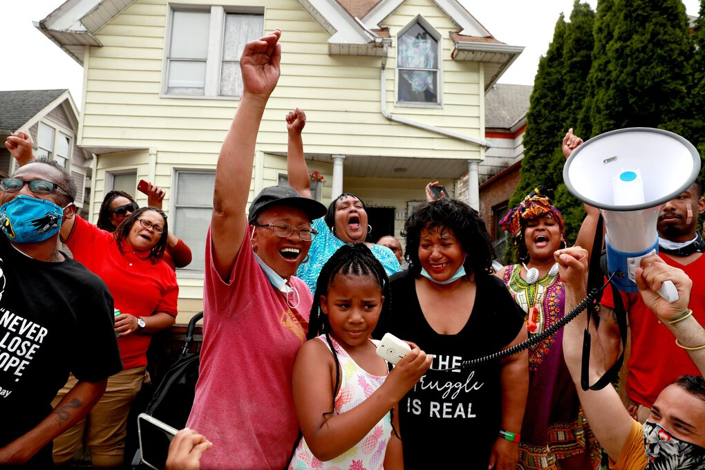 Relatives cheer Lanai Stenson, 7, center, who talks on the megaphone to the crowds at the Juneteenth Freedom March & Celebration in Seattle Friday. (Erika Schultz / The Seattle Times)
