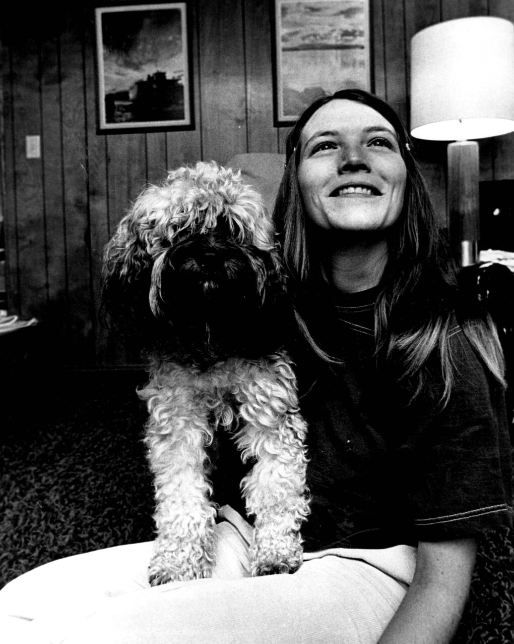 Christine Wren and her dog, Arrow, relax at her Seattle home in February 1975. Wren was the first woman hired as a professional baseball umpire, in 1975.  (Greg Gilbert / The Seattle Times, 1975)