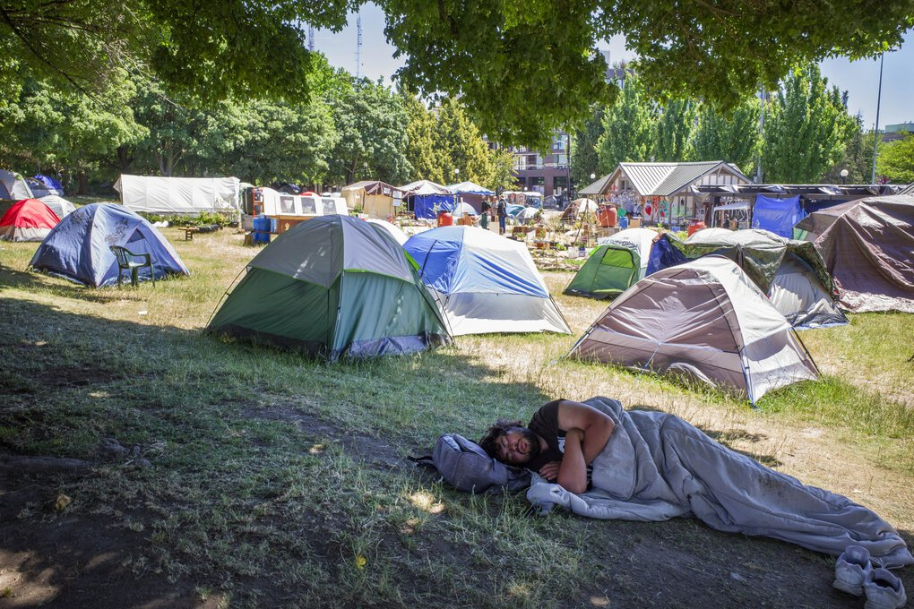Tents are set up around a new community garden at Cal Anderson Park in the Capitol Hill Organized Protest zone, or CHOP. (Steve Ringman / The Seattle Times)