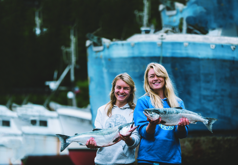 "Sisters Claire Neaton, left, and Emma Teal Laukitis grew up on a remote homestead in Alaska. They have written about their lives in their new book, ""The Salmon Sisters: Feasting, Fishing, and Living in Alaska."" (Camrin Dengel / Courtesy Sasquatch Books)"