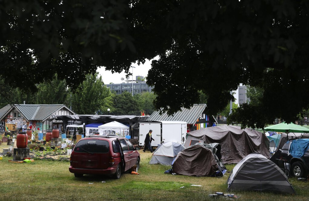 Tents are seen inside Cal Anderson Park at the  Capitol Hill Organized Protest, or CHOP, early Sunday morning. (Ken Lambert / The Seattle Times)