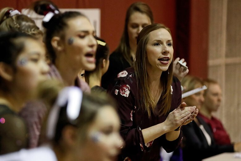 SPU gymnastics coach Sarah Jean Marshall seen at a meet as the Falcons compete at Brougham Pavilion in Seattle. (Courtesy J. Andrew Towell)