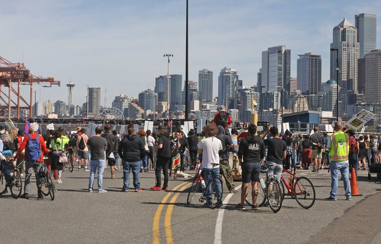 Members of ILWU Local 19 gather at Terminal 46 in Seattle as part of the union's West Coast Juneteenth rally and port shutdown Friday. (Greg Gilbert / The Seattle Times)