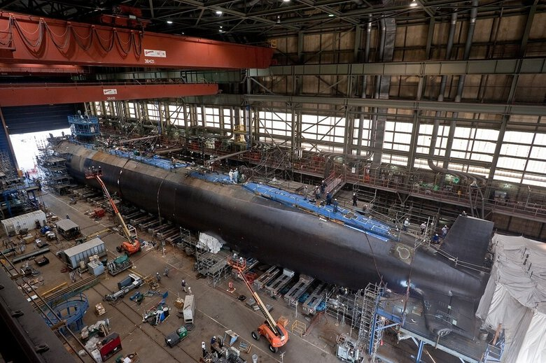 The Justice Department has reached a $10.9 million settlement with a defense contractor accused of producing substandard castings for Navy submarines at a Tacoma foundry and falsifying test results to cover it up. Above, the Virginia-class attack submarine Minnesota (SSN 783) is shown under construction in 2012 at Newport News Shipbuilding in Newport News, Va. (Chris Oxley / Navy)