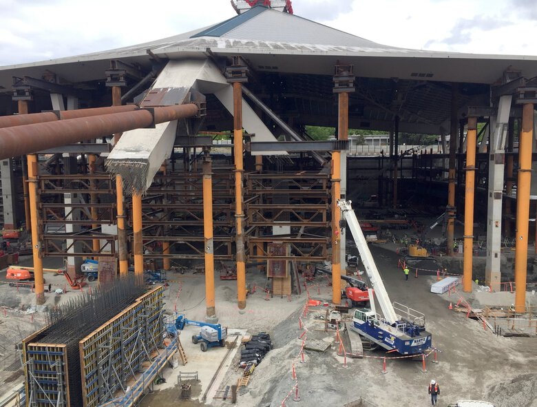 A kickstand support is being built up at the south end of KeyArena, where it will attach to an upper column now hanging in midair. (Geoff Baker / The Seattle Times)