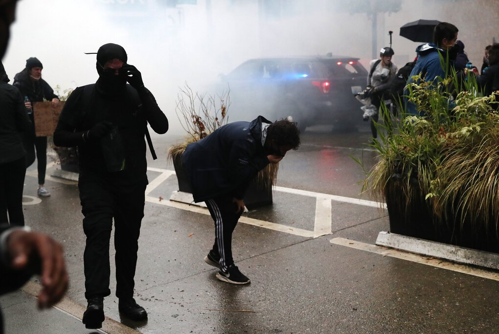 Police deploy tear gas at protesters to disperse the crowd gathered to protest the killing of George Floyd, a Black man, by a white Minneapolis police officer, in downtown Seattle on May 30. Seattle's mayor and police chief said Friday tear gas would be banned for 30 days, but it has been used since. (Amanda Snyder / The Seattle Times)