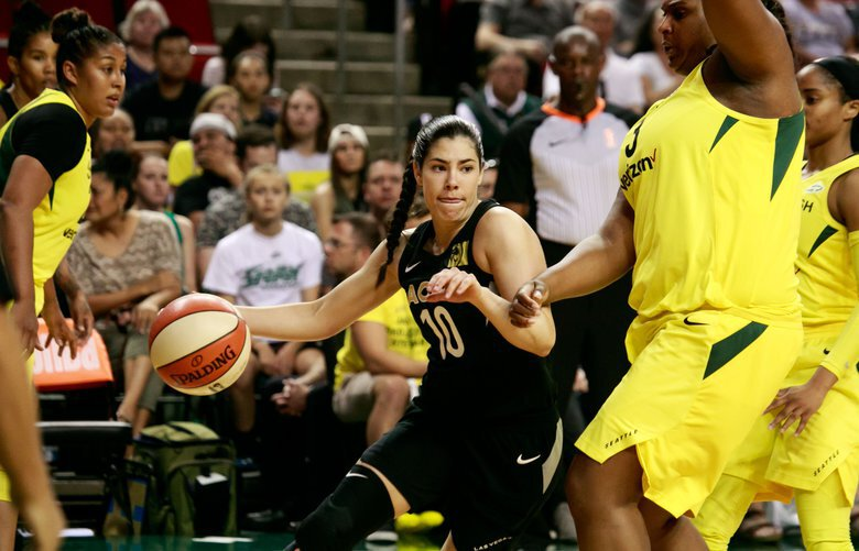 Las Vegas Guard Kelsey Plum (10) looks for a pass during the first quarter of the Seattle Storm versus Las Vegas Aces game at KeyArena in Seattle Tuesday, June 19, 2018.  206676