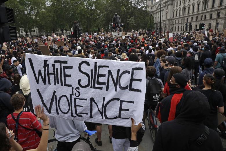 FILE – In this Wednesday, June 3, 2020 file photo protesters gather during a demonstration in Parliament Square in London over the death of George Floyd, a black man who died after being restrained by Minneapolis police officers on May 25. (AP Photo/Matt Dunham, File)