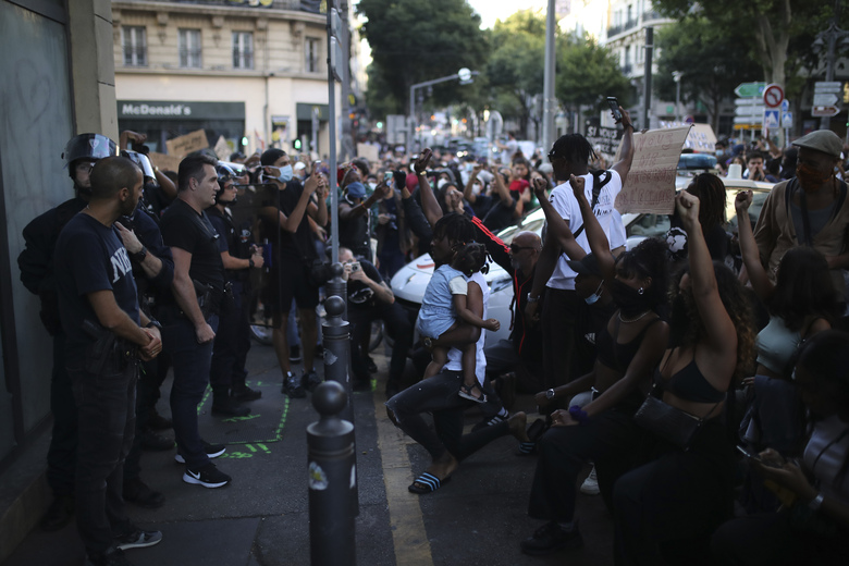 FILE – In this Tuesday, June 2, 2020 file photo protesters face police officers during a demonstration in Marseille, southern France. Thousands of people defied a police ban and converged on the main Paris courthouse for a demonstration to show solidarity with U.S. protesters and denounce the death of a black man in French police custody. (AP Photo/Daniel Cole, File)