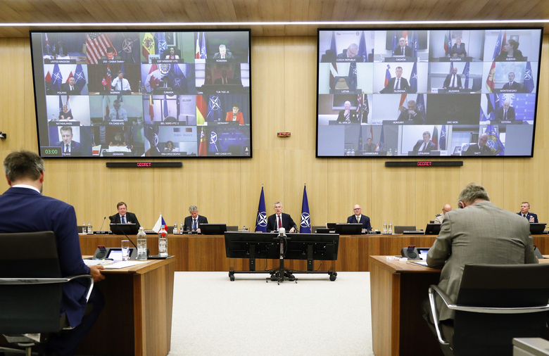 NATO Secretary General Jens Stoltenberg, center, speaks during a video conference of NATO Defense Minister at the NATO headquarters in Brussels, Wednesday, June 17, 2020. NATO Defense Ministers began two days of video talks focused on deterring Russian aggression and a US decision to withdraw thousands of troops from Germany. (Francois Lenoir, Pool Photo via AP)