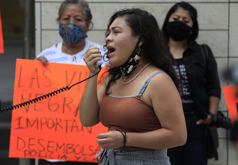 Immigration activist Claudia Rueda tears up as she addresses young immigrants celebrating the Deferred Action for Childhood Arrivals program, or DACA, in Los Angeles, Thursday, June 18, 2020. DACA recipients reacted with a mixture of relief and gratitude over the Supreme Court ruling to reject President Donald Trump's effort to end legal protections for 650,000 immigrants under DACA. (AP Photo/Damian Dovarganes)