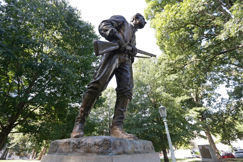 FILE – This Sept. 19, 2017, file photo shows a Confederate monument honoring Henry Lawson Wyatt at the state Capitol in Raleigh, N.C. News outlets report that crews Saturday morning, June 20, 2020 were removing this and another statue in the area dedicated to the women of the Confederacy. (AP Photo/Gerry Broome, File)