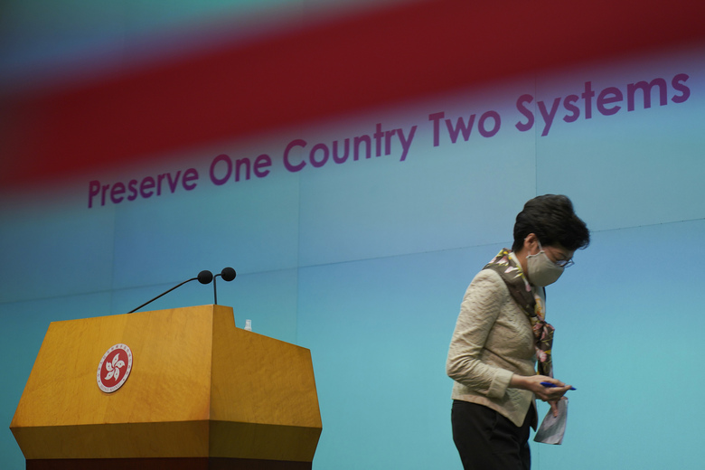 """Hong Kong Chief Executive Carrie Lam leaves after a press conference in Hong Kong, Tuesday, June 2, 2020. Lam hit out at the """"double standards"""" of foreign governments over national security, and pointed to recent unrest in America as an example. (AP Photo/Vincent Yu)"""
