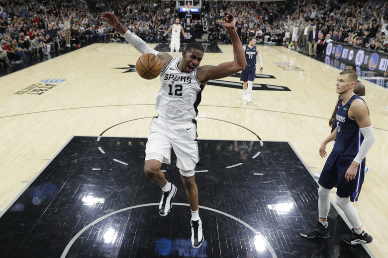 FILE – In this March 10, 2020, file photo, San Antonio Spurs forward LaMarcus Aldridge (12) celebrates as he scores against the Dallas Mavericks during the second half of an NBA basketball game in San Antonio. Aldridge will miss the remainder of San Antonio's season while he recovers from surgery on his right shoulder. (AP Photo/Eric Gay, File)
