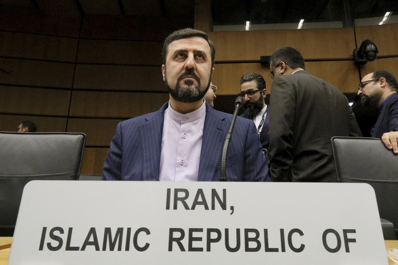 FILE – In this Thursday, Nov. 21, 2019 file photo Iran's Ambassador to the International Atomic Energy Agency, IAEA, Kazem Gharibabadi, waits for the start of the IAEA board of governors meeting at the International Center in Vienna, Austria. The board of the United Nations' atomic watchdog agency on Friday adopted a resolution calling for Iran to provide inspectors access to sites where the country is thought to have stored or used undeclared nuclear material. (AP Photo/Ronald Zak, file)