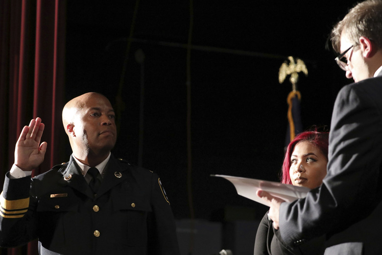 FILE – In this Sept. 8, 2017, file photo, newly appointed Minneapolis Police Chief Medaria Arradondo takes the oath of office as his daughter Nyasia looks on during a public swearing-in ceremony, in Minneapolis. George Floyd's death and the protests it ignited nationwide over racial injustice and police brutality have raised questions about whether Arradondo — or any chief — can fix a department that's now facing a civil rights investigation. (Anthony Souffle/Star Tribune via AP, File)