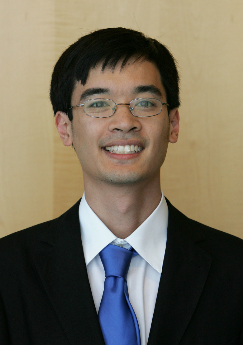 In this Aug. 22, 2006 file photo, mathematician Terence Tao poses for the media before a press conference in Madrid. An international team of mathematicians whose theories have improved the compression of large digital files of data, including images and sound, will be recognized by one of this year's Princess of Asturias awards, one of the most prestigous in the Spanish-speaking world. The Spanish foundation that organizes the annual awards announced Tuesday that the 2020 prize for Scientific and Technical Investigation will go to Yves Meyer, Ingrid Daubechies, Terence Tao and Emmanuel Candes. (AP Photo/Bernat Armangue, FILE)