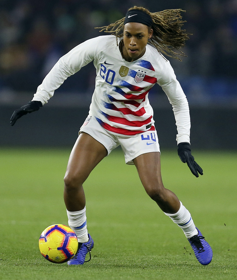 FILE – In this Jan. 19, 2019, file photo, United States forward Jessica McDonald controls the ball during a women's international friendly soccer match againset France at the Oceane stadium in Le Havre, France. There are just a handful of mothers who play professional soccer in the NWSL. But when the league asks players to travel to Utah and be sequestered for more than a month, moms' voices are important. North Carolina Courage forward Jessica McDonald, whose son Jeremiah is 8 years old. She spoke up to new NWSL Commissioner Lisa Baird and got the moms on a call to discuss the tournament.  (AP Photo/David Vincent, File)