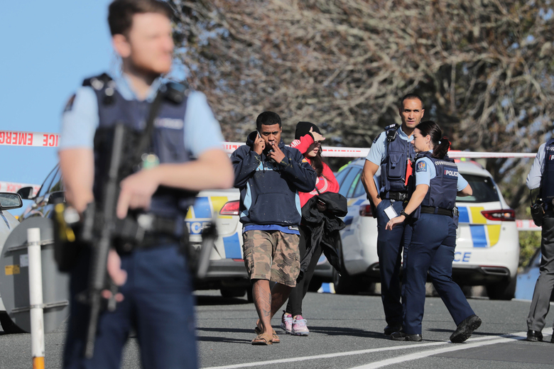 Armed police guard at the scene of a shooting incident following a routine traffic stop in Auckland, New Zealand, Friday, June 19, 2020. New Zealand police say a few officers have been shot and seriously injured and a suspect is on the run. (Michael Craig/New Zealand Herald via AP)