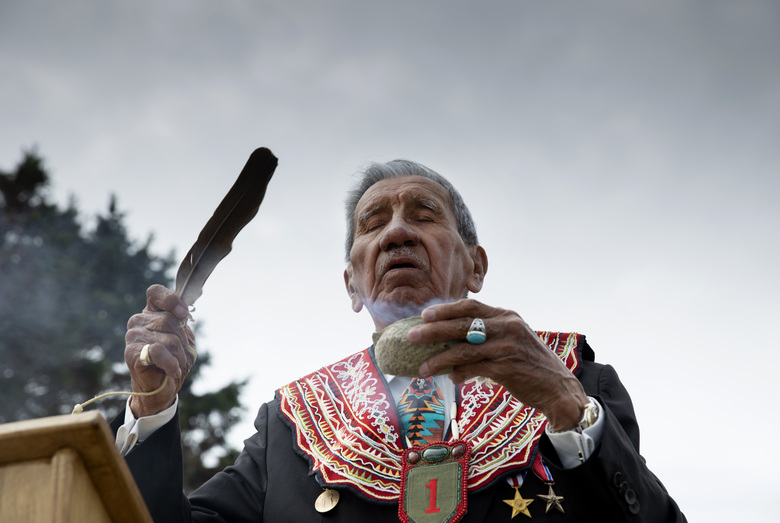 World War II D-Day veteran and Penobscot Elder from Maine, Charles Norman Shay performs a ritual of the 4 directions during a Native American ceremony at his memorial overlooking Omaha Beach in Saint-Laurent-sur-Mer, Normandy, France, Friday, June 5, 2020. Saturday's anniversary of D-Day will be one of the loneliest remembrances ever, as the coronavirus pandemic is keeping almost everyone away, from government leaders to frail veterans who might not get another chance for a final farewell to their unlucky comrades. (AP Photo/Virginia Mayo)