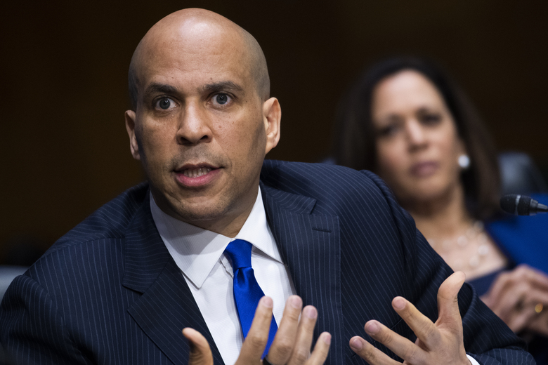 Sen. Cory Booker, D- N.J., speaks as Sen. Kamala Harris, D-Calif., look on during a Senate Judiciary Committee hearing on police use of force and community relations on on Capitol Hill, Tuesday, June 16, 2020 in Washington. (Tom Williams/CQ Roll Call/Pool via AP)