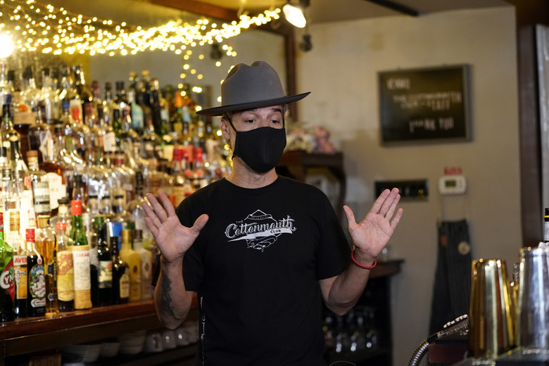 Michael Neff, co-owner of the Cottonmouth Club, talks about the spread of COVID-19 Tuesday, June 23, 2020, in Houston. Neff closed his downtown bar because of concerns within the industry as number COVID-19 case continues to rise in Houston. (AP Photo/David J. Phillip)