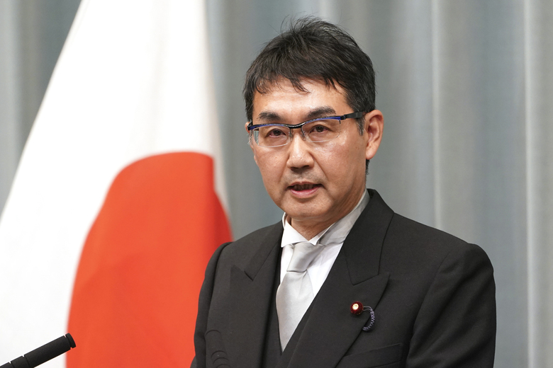 FILE – In this Sept. 11, 2019, file photo, Japan's Justice Minister Katsuyuki Kawai speaks during a press conference at the prime minister's official residence in Tokyo. Kawai and his lawmaker wife Anri Kawai were arrested Thursday, June 18, 2020, over allegations they engaged in vote buying during last year's election. Prosecutors arrested the couple on suspicion that they offered millions of yen in cash to dozens of voters ahead of the 2019 upper house election in which Anri Kawai won a seat, officials and media reports said. (AP Photo/Eugene Hoshiko, File)