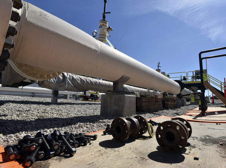 FILE – In this June 8, 2017, file photo, fresh nuts, bolts and fittings are ready to be added to the east leg of the Enbridge Line 5 pipeline near St. Ignace, Mich., as Enbridge prepares to test the east and west sides of the Line 5 pipeline under the Straits of Mackinac in Mackinaw City, Mich. A Michigan regulatory panel refused Tuesday, June 30, 2020, to grant quick permission to run a new oil pipeline beneath a channel that connects two of the Great Lakes, deciding instead to conduct a full review.Enbridge filed an application in April with the Michigan Public Service Commission to relocate a segment of its Line 5 that extends beneath the Straits of Mackinac, which links Lakes Huron and Michigan.(Dale G. Young/Detroit News via AP, File)