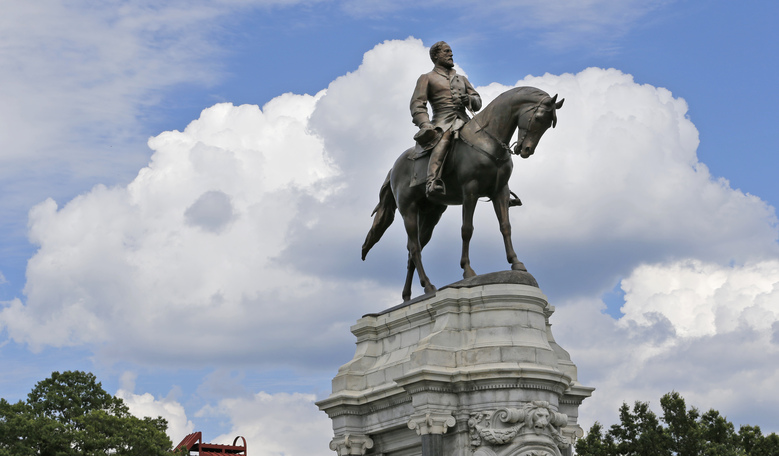 FILE – This Tuesday June 27, 2017 file photo shows the statue of Confederate General Robert E. Lee that stands in the middle of a traffic circle on Monument Avenue in Richmond, Va. Virginia Gov. Ralph Northam is expected to announce plans Thursday, June 4, 2020 for the removal of an iconic statue of Confederate Gen. Robert E. Lee from Richmond's prominent Monument Avenue. (AP Photo/Steve Helber, file)