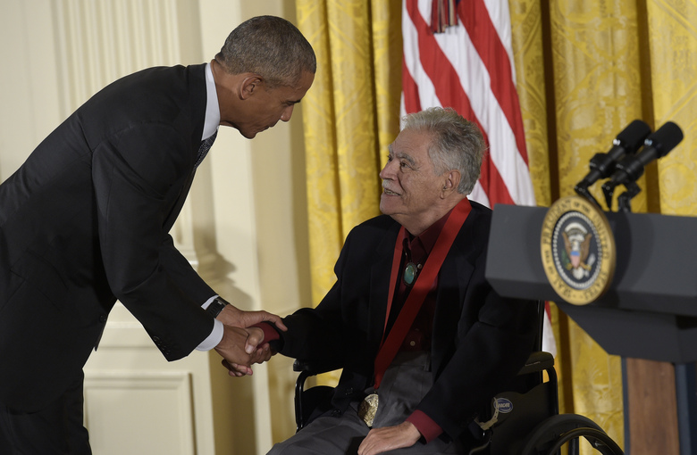 "FILE – In this Sept. 22, 2016, file photo, President Barack Obama shakes hands with author, Rudolfo Anaya, after presenting him with the 2015 National Humanities Medal during a ceremony in the East Room of the White House in Washington. Anaya, 82, who helped launch the 1970s Chicano Literature Movement with his novel ""Bless Me, Ultima,"" died Sunday, June 28, 2020. (AP Photo/Susan Walsh, File)"