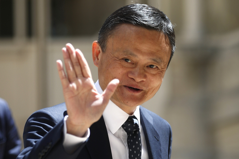 FILE – In this May 15, 2019, file photo, founder of Alibaba group Jack Ma arrives for the Tech for Good summit in Paris. As the coronavirus spread, the world's richest communist dug into his deep pockets. Jack Ma, founder of e-commerce giant Alibaba Group and a member of the ruling Communist Party, helped to pay for 1,000 ventilators delivered to New York in April. Ma's foundation also is giving ventilators, masks and other supplies in Africa, Latin America and Asia. (AP Photo/Thibault Camus, File)