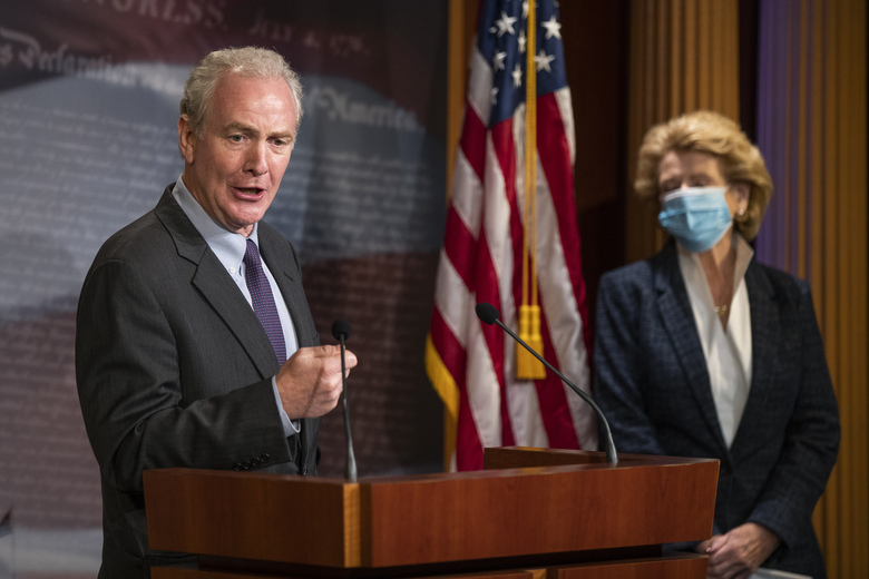 Sen. Chris Van Hollen, D-Md., with Sen. Debbie Stabenow, D-Wis., right, speaks during a news conference on Capitol Hill, Tuesday, June 16, 2020, in Washington. (AP Photo/Manuel Balce Ceneta)