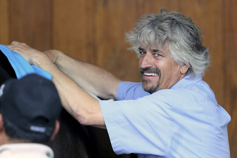 FILE – In this May 1, 2019, file photo, trainer Steve Asmussen smiles at Churchill Downs in Louisville, Ky. Hall of Famer Steve Asmussen became the all-time leading trainer at Churchill Downs on Friday, June 12, 2020, saddling Drop Dead Gorgeous to a win in the first race for his 738th victory beneath the Twin Spires. (AP Photo/Gregory Payan, File)