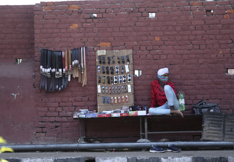 A roadside vendor waits for customers in Jammu, India, Monday, June 15, 2020. India is the fourth hardest-hit country by the COVID-19 pandemic in the world after the U.S., Russia and Brazil. (AP Photo/ Channi Anand)