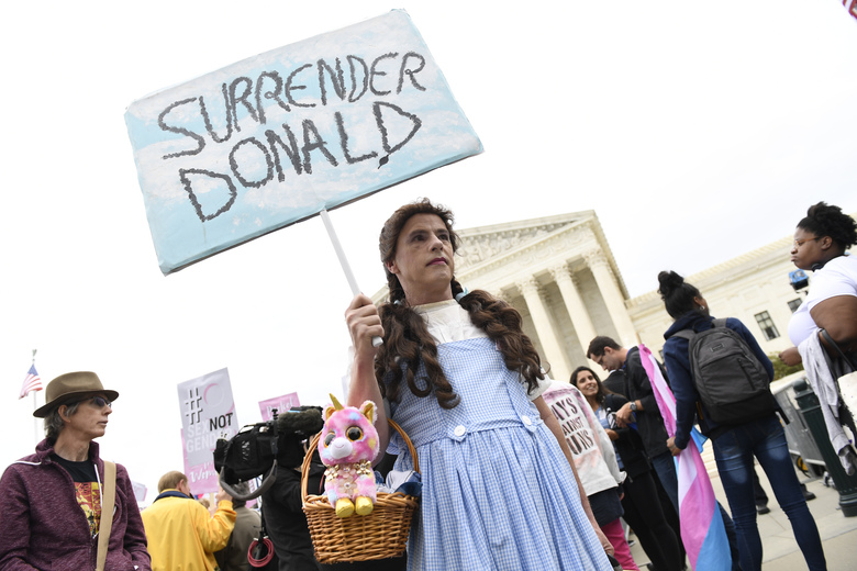 FILE – In this Oct. 8, 2019, file photo, Mike Hisey, of New York City, protests outside the Supreme Court in Washington, where the Supreme Court is hearing arguments in the first case of LGBT rights since the retirement of Supreme Court Justice Anthony Kennedy. LGBT-rights activists are looking ahead as they celebrate a major victory in the Supreme Court regarding job discrimination, They hope the June 15, 2020, decision spurs action against other forms of bias against their community and undermines the Trump administration's near-total ban on military service by transgender people. (AP Photo/Susan Walsh, File)
