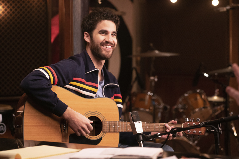 """This image released by Quibi shows Darren Criss in a scene from Quibi's new 12-part series """"Royalties."""" The satirical look at music industry has a fresh song in every episode and allows Criss to show off more than his acting chops: He wrote all the music, from a raunchy rap song to pure, irresistible pop. (Kevin Estrada/Quibi via AP)"""